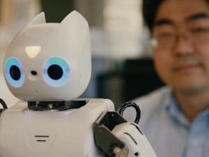 The Darwin-OP2 robot and its creator, Chung Hyuk Park of George Washington University. (Photo: George Washington University)